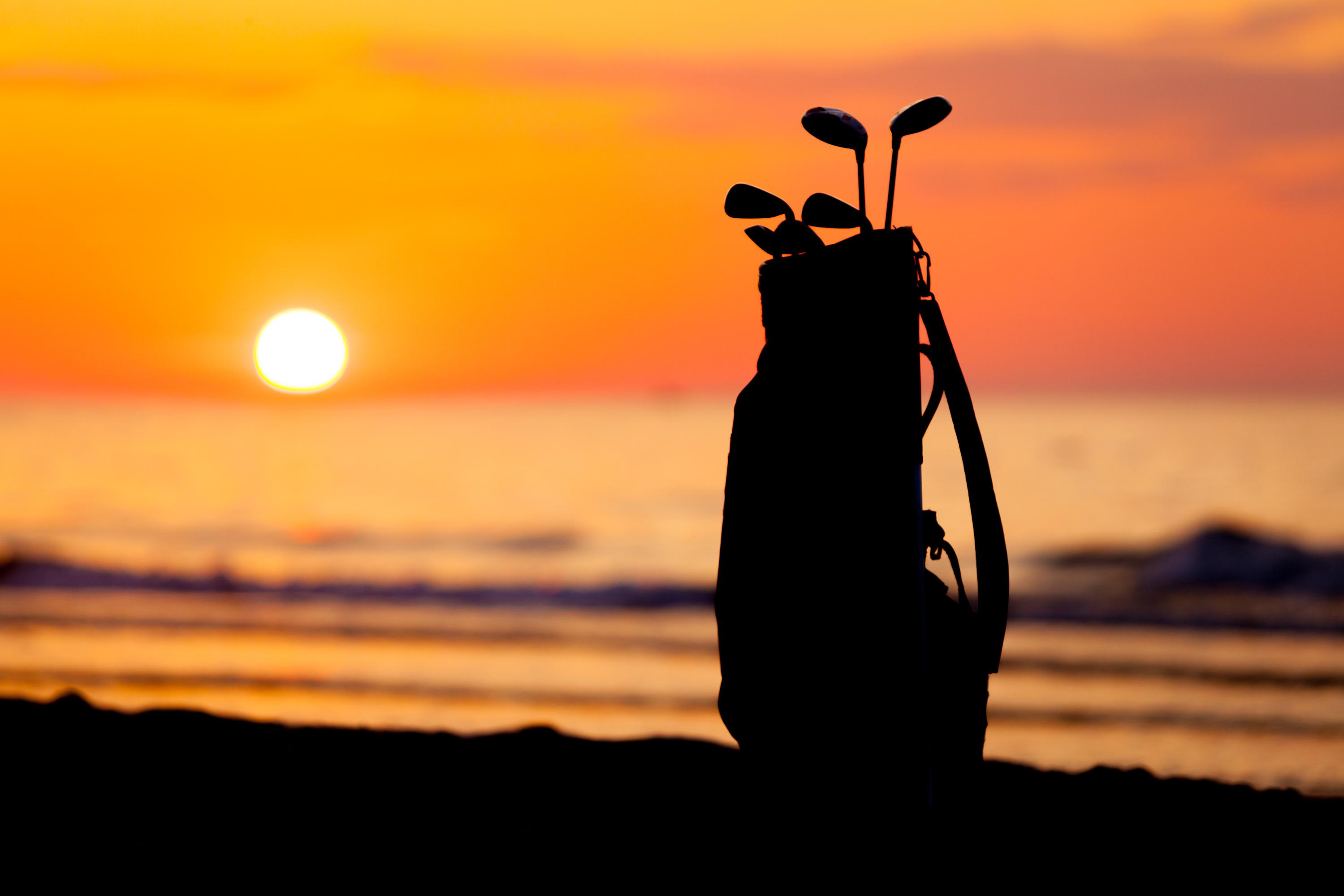 Idyllic shot of sunset and golf clubs
